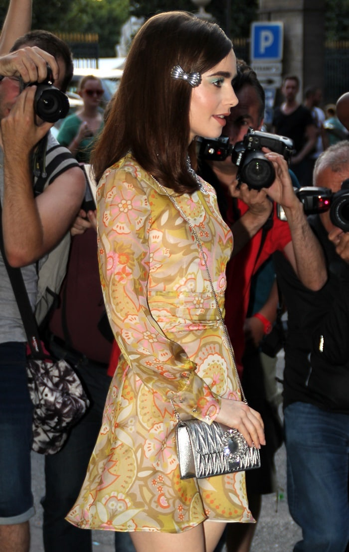 Lily Collins toting a chrome leather My Miu shoulder bag