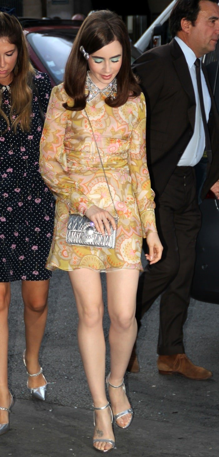 Lily Collins flaunting her toned legs during the Miu Miu 2019 Cruise Collection fashion show held at Hotel Regina in Paris, France, on June 30, 2018
