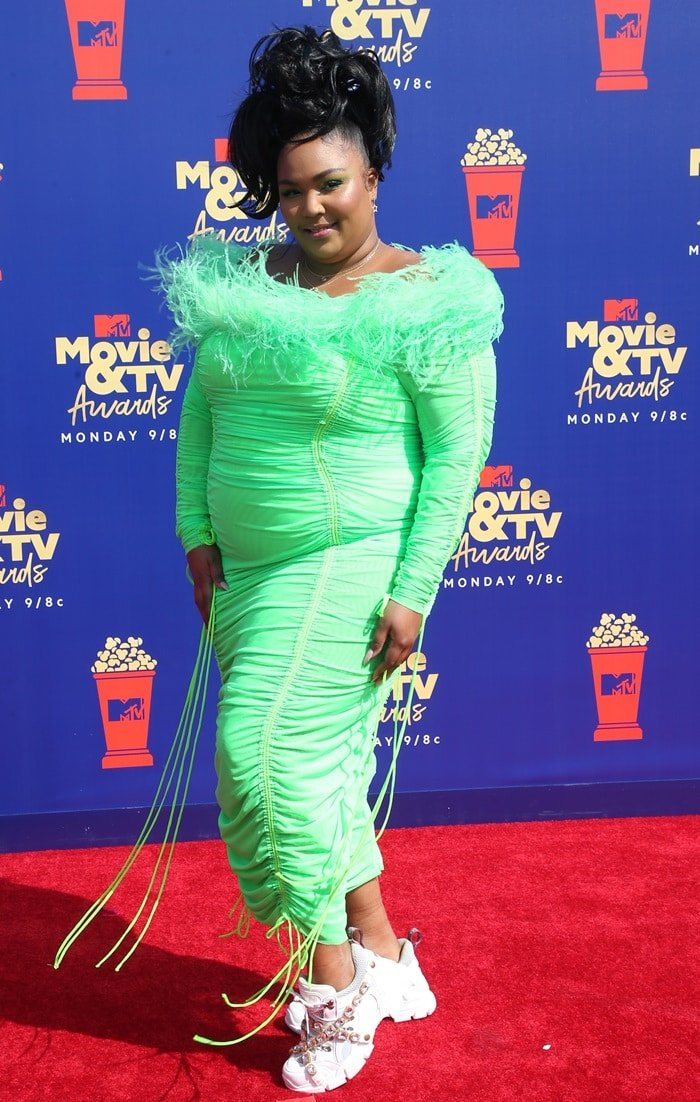 Lizzo styled a neon green Christopher John Rogers dress with white Flashtrek sneakers