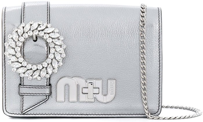 This chrome leather My Miu shoulder bag features a foldover top with magnetic closure, a main internal compartment, a chain link fastening and crystal accents
