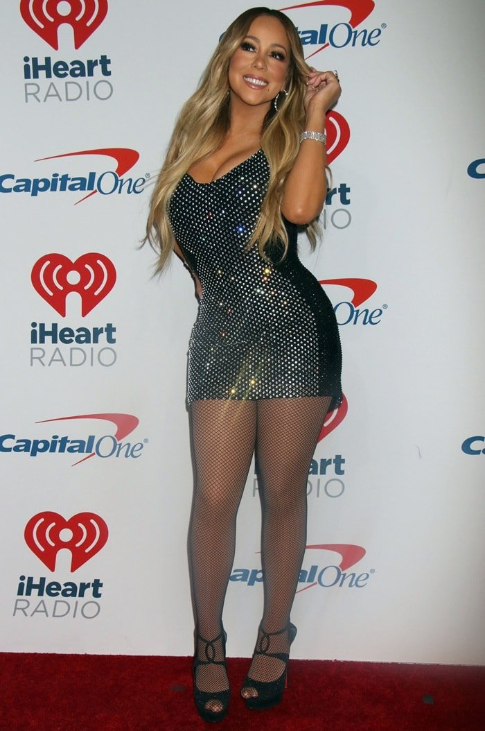 Mariah Carey shows off her sexy legs in a custom blue sequinned mini Bryan Hearns dress