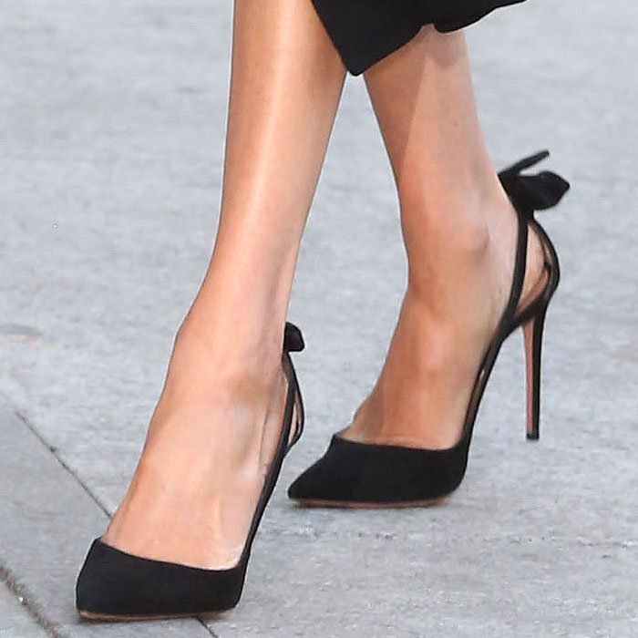 Meghan Markle shows off her feet in her favorite Aquazzura Deneuve cutout-side bow-back pumps