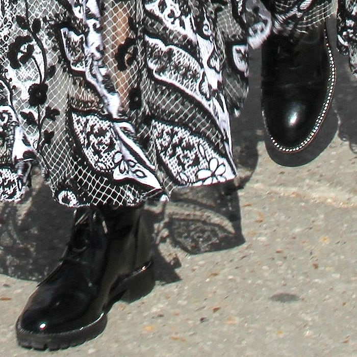 Details of the popular Christian Dior 'Rebelle' boots on Olivia Palermo.