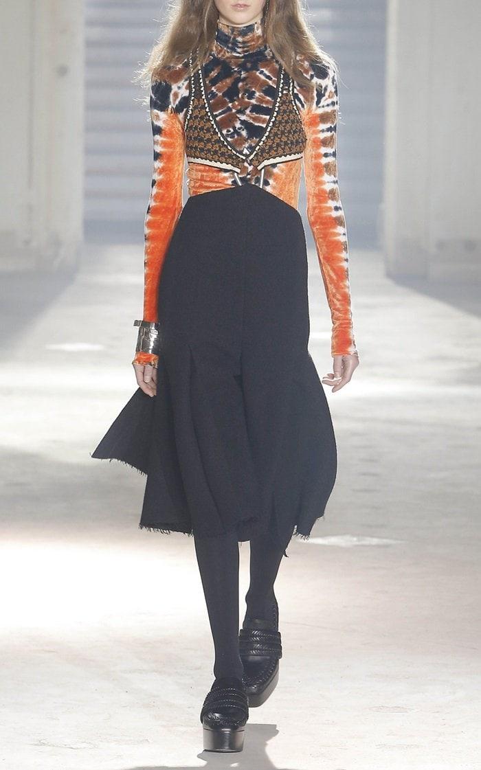 This Proenza Schouler Cutout A-Line Dress features a deep v-neckline and frayed knee length hem