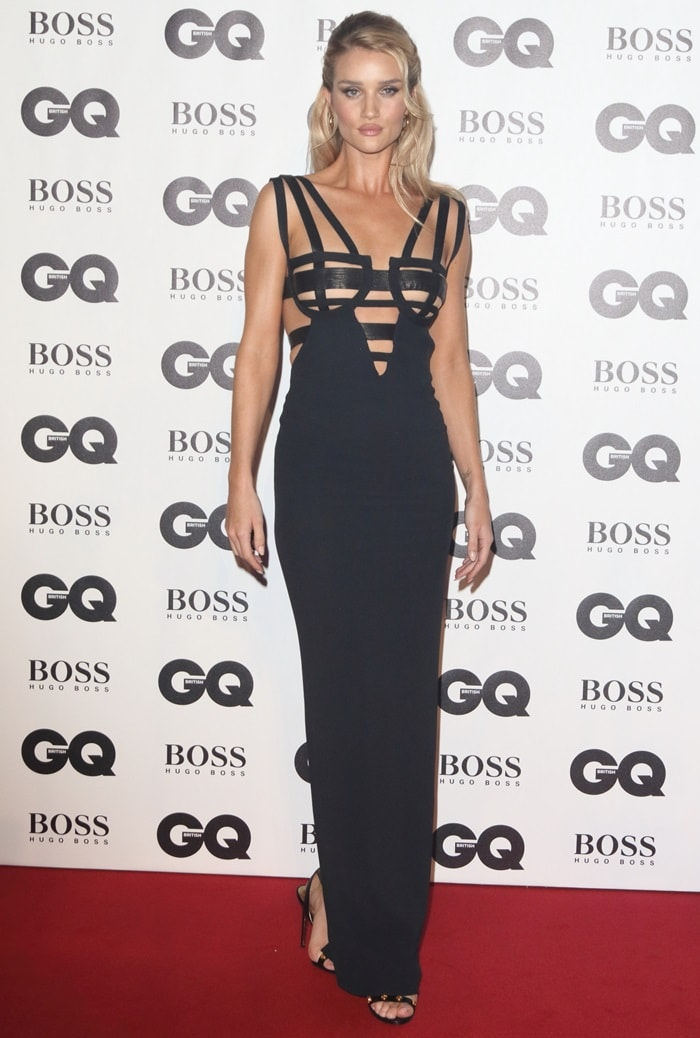 Rosie Huntington-Whiteley in custom Versace strappy black gown featuring cut-out panels across the bodice