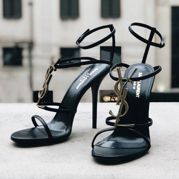 Saint Laurent's Cassandra sandals proudly display the label's YSL metallic monogram plaque