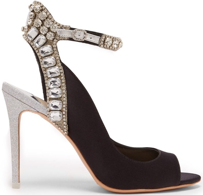 Imbued with glamour, these black satin sandals are set on a silver glitter heel with a crystal-embellished strap that will dazzle with every step