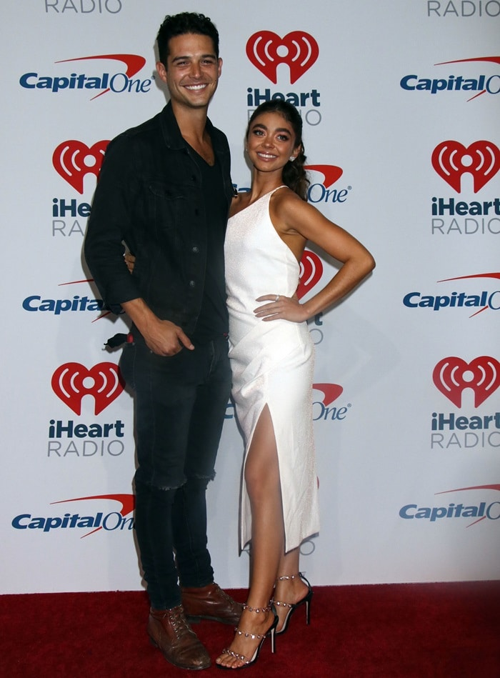 Sarah Hyland and her boyfriend Wells Adams in the press room at the 2018 iHeartRadio Music Festival at the T-Mobile Arena in Las Vegas on September 21, 2018