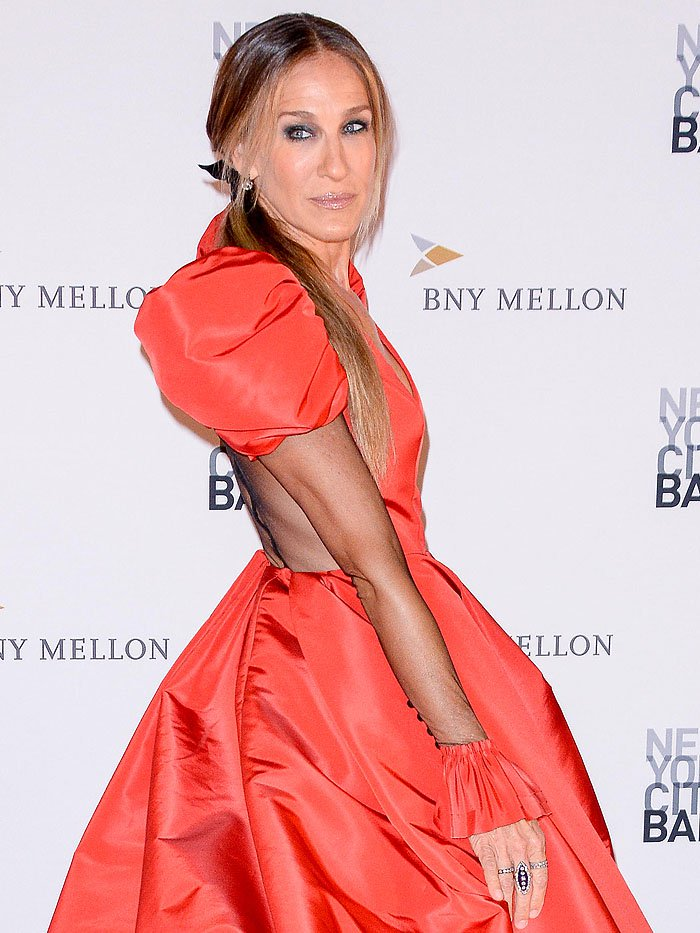 53-year-old actress Sarah Jessica Parker showing off her Giles Deacon gown's sheer back with a velvet stripe down the middle