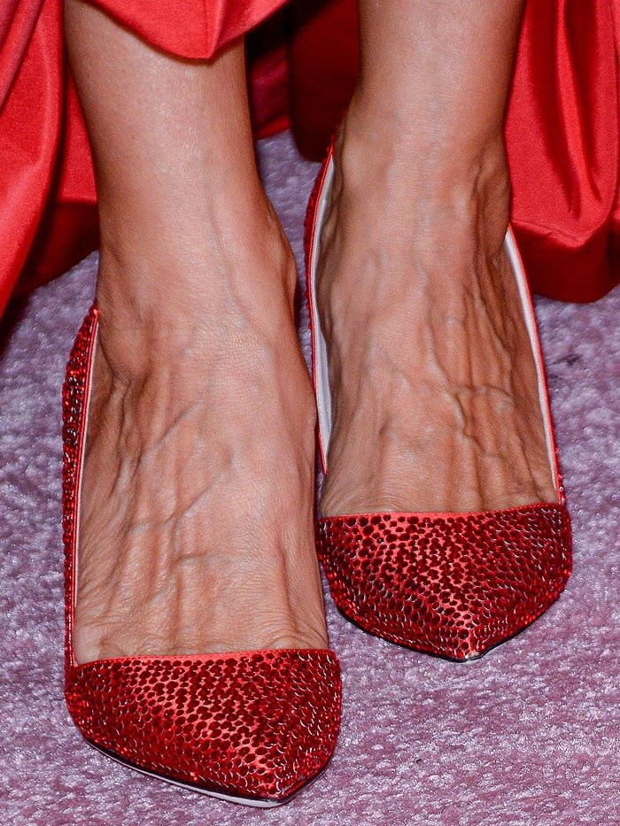 Sarah Jessica Parker's feet in rhinestone-encrusted red-satin pumps