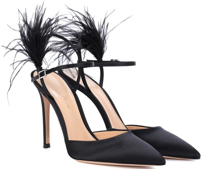 These elegant shoes have been crafted in Italy from smooth and sheeny satin and are tipped with voluminous feathers for statement sophistication