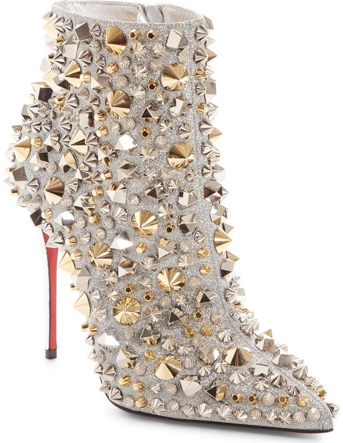 Silvery and golden spikes maximize the shine on a glittering bootie designed to steal the spotlight.