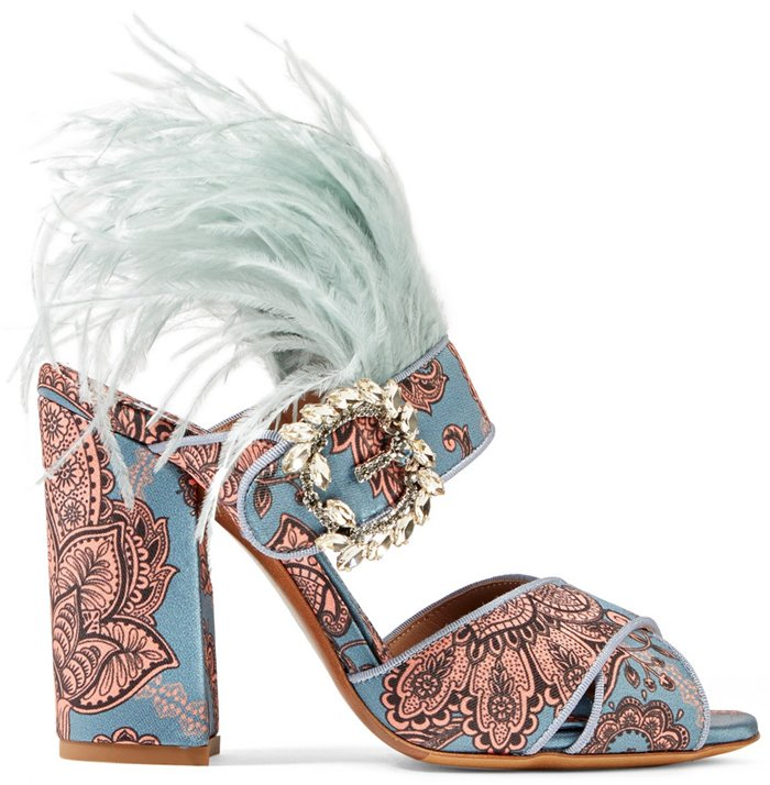 Made in Italy, they're detailed with a decorative crystal-embellished brooch and topped with wispy mint feathers