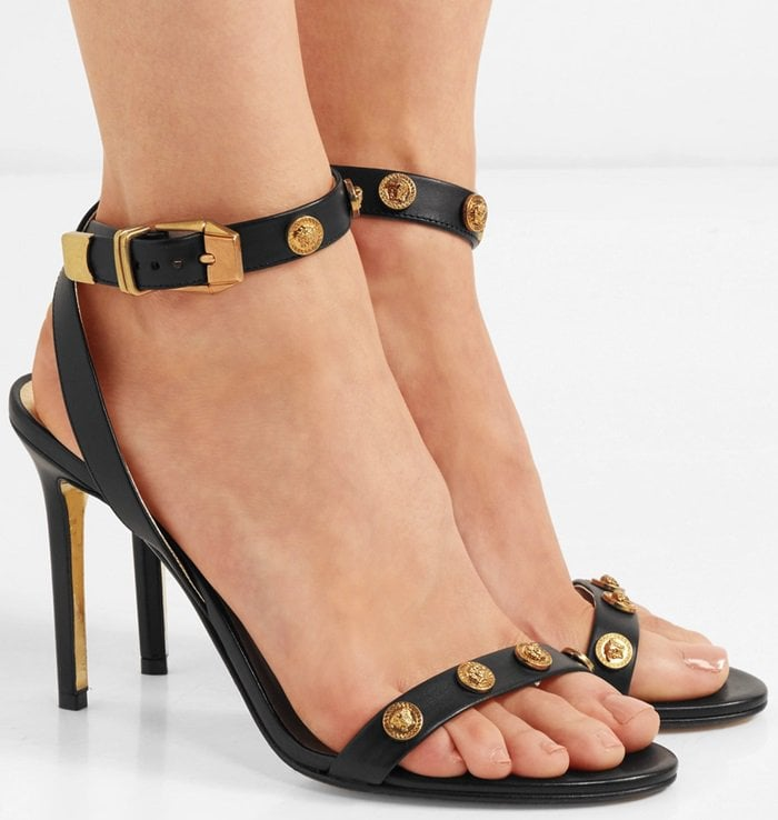 Sandals studded with gold Medusa heads designed by Gianni Versace