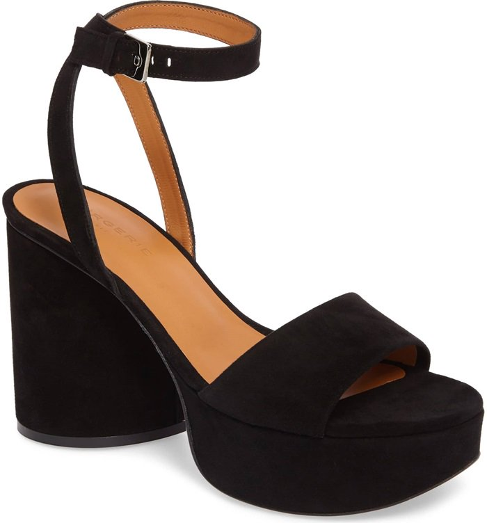 With its chunky heel and slender ankle strap, this bold platform sandal in jet-black suede is the perfect finish to party-season looks
