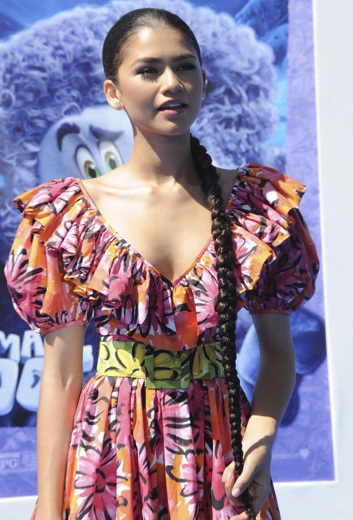 Zendaya wearing a pink and orange V-neck mini dress by Michael Kors