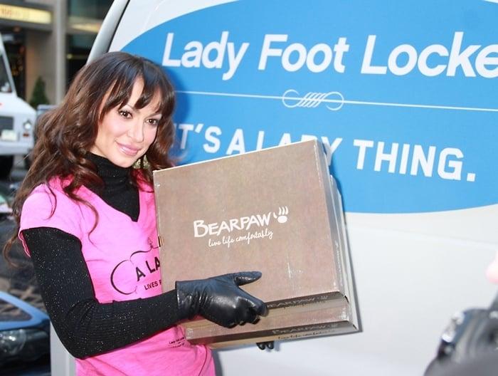 Soviet-born American professional ballroom dancer Karina Smirnoff attends the Bearpaw boots charity event at Lady Foot Locker