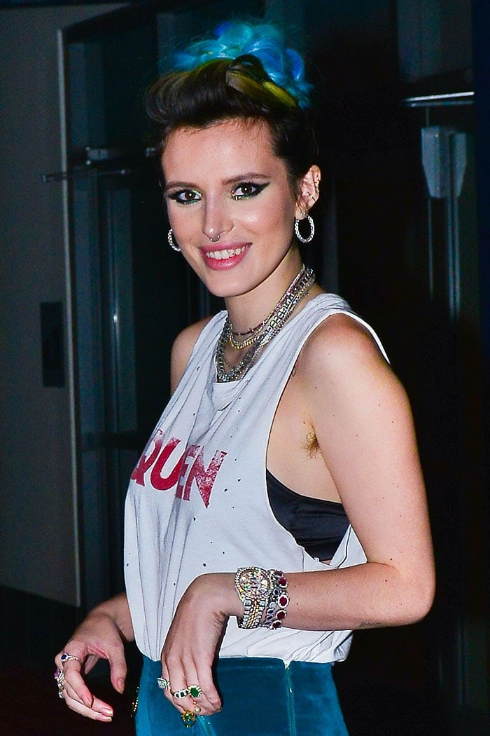 Bella Thorne rocking armpit hair in a Queen cutoff t-shirt
