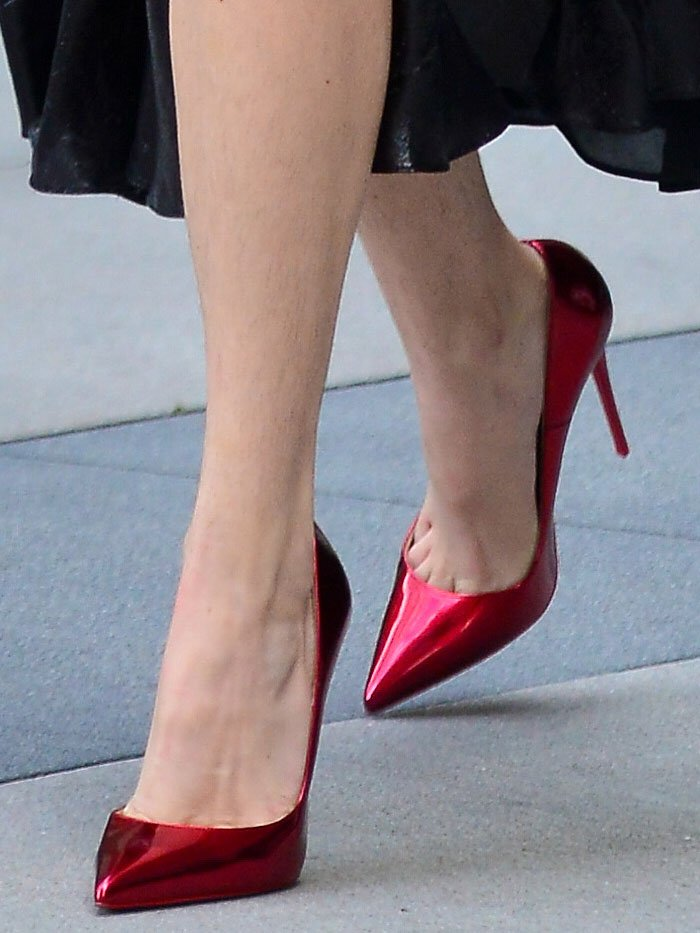 Bella Thorne with hairy legs in metallic-red Christian Louboutin 'So Kate' pumps