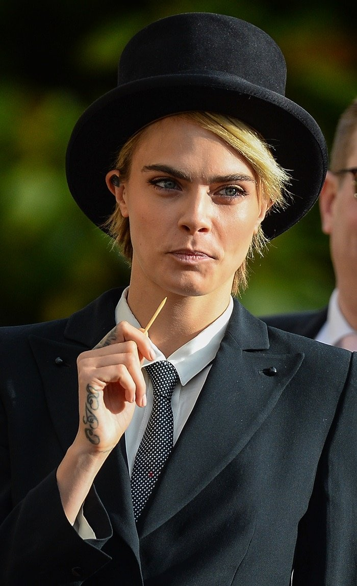 Cara Delevingne did her best to grab attention with a toothpick at the wedding of Princess Eugenie and Jack Brooksbank