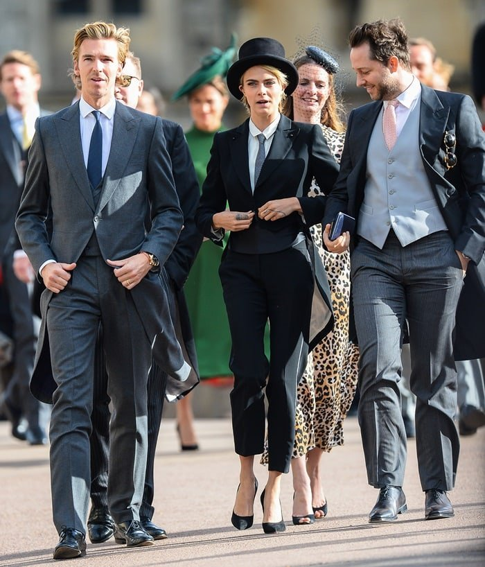 Cara Delevingne wore black Casadei Blade pumps with her tuxedo