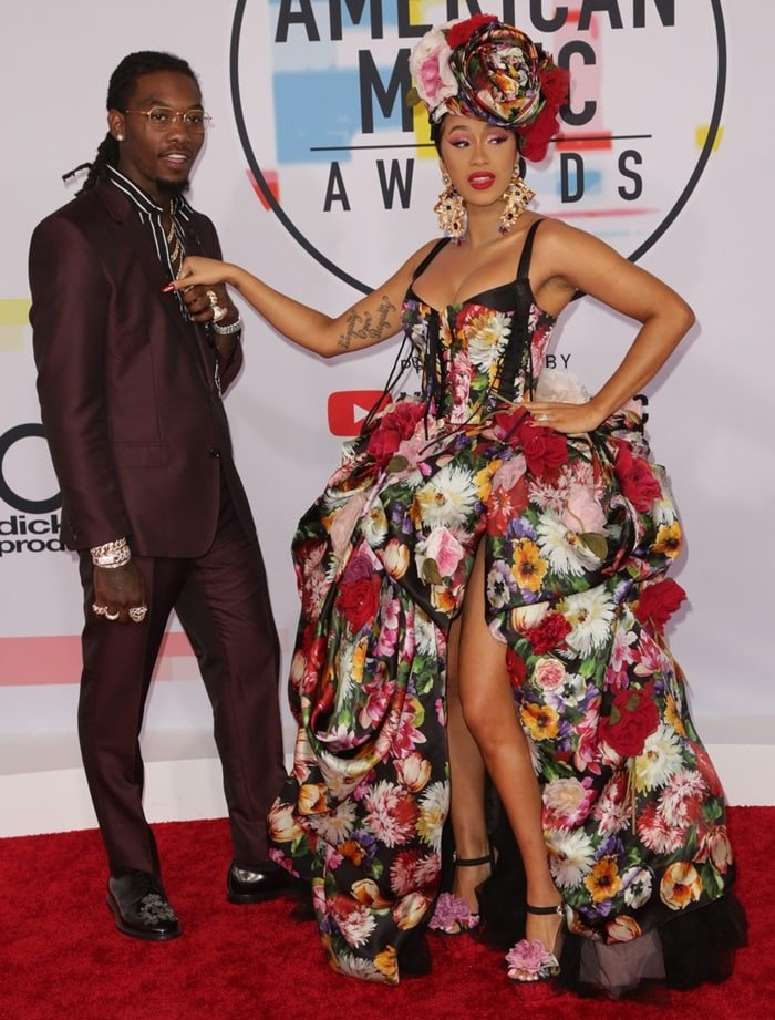 Cardi B posing with her husband Offset on the red carpet at the 2018 American Music Awards at the Microsoft Theater in Los Angeles on October 9, 2018