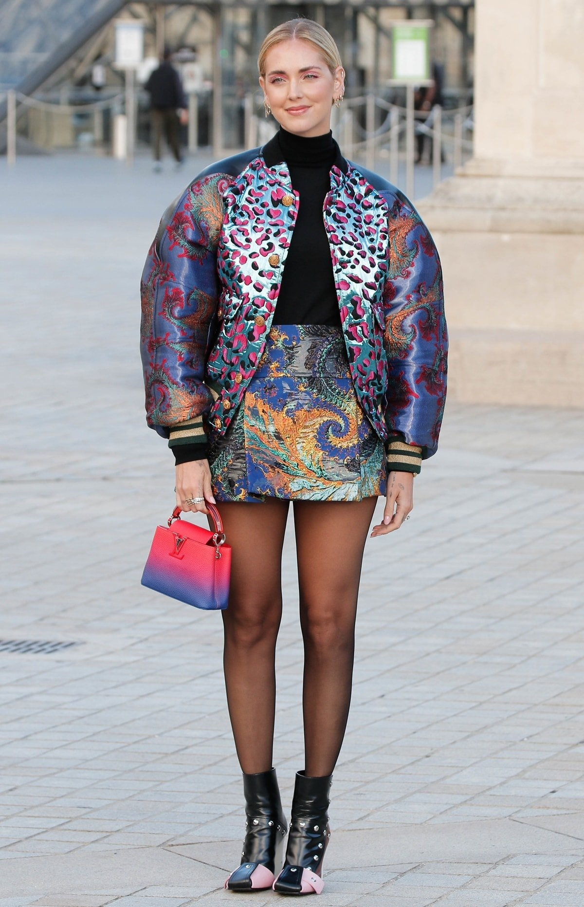 Chiara Ferragni arrives in Patti wedge ankle boots at the Louis Vuitton show