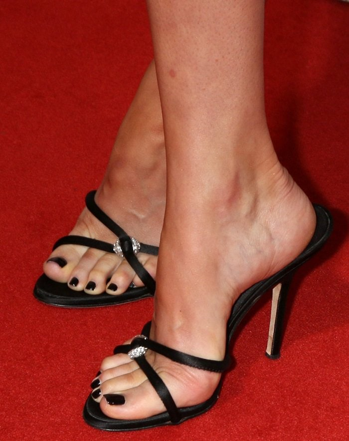 Dakota Johnson shows off her feet in black Giuseppe Zanotti Pauline mule sandals with crystal detail