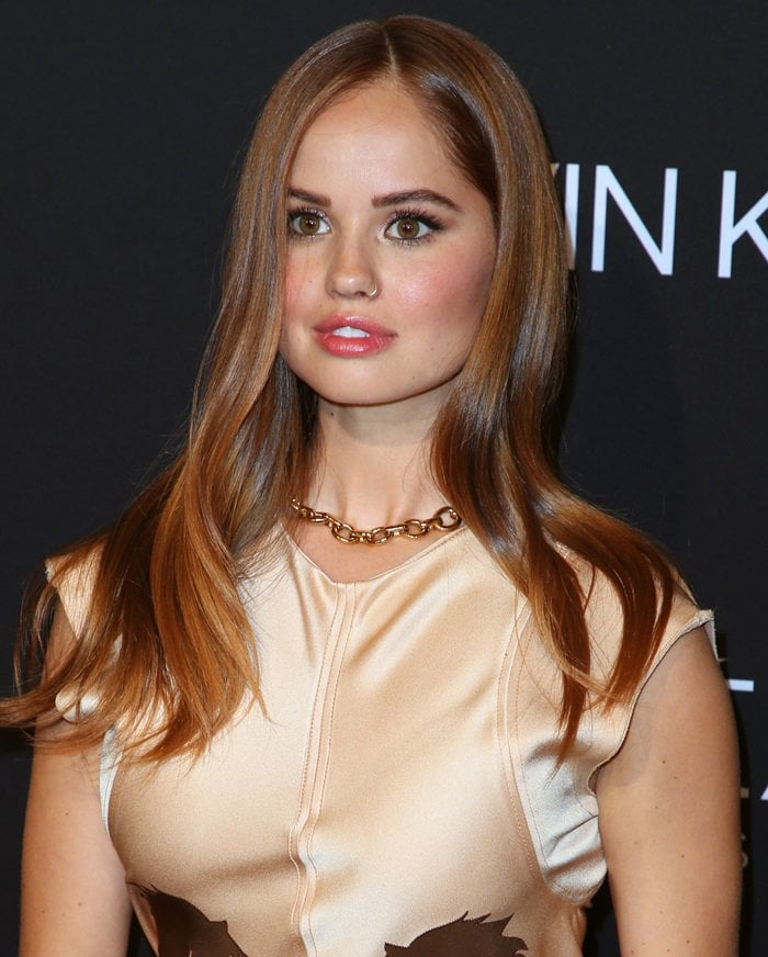 Debby Ryan shows off her logo chain choker necklace