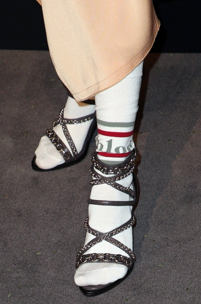 Debby Ryan rocks white logo socks by Chloé