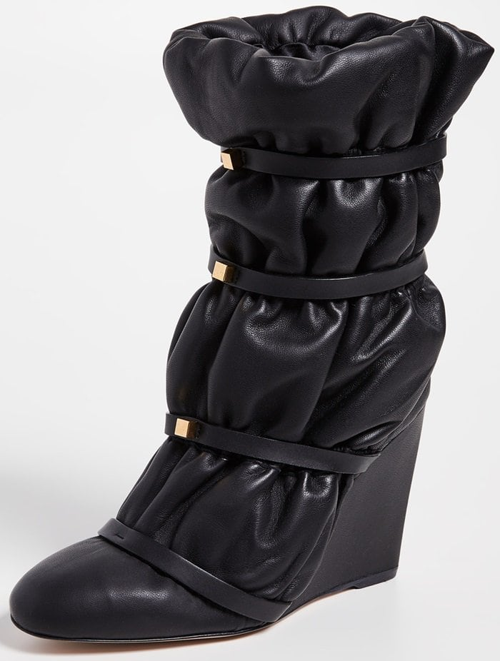 Would you wear theseglossy leather boots cinched with studded leather straps?