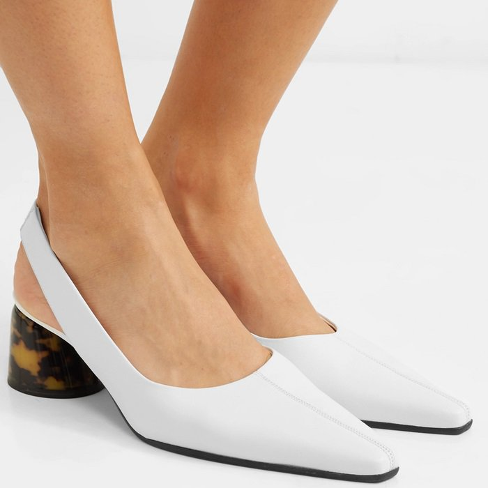These practical pumps have been made in Italy from supple white leather and secure with an elasticated slingback strap