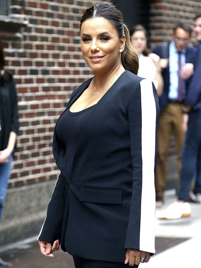 Eva Longoria in an ill-fitting black blazer with wide, white stripes on the sleeves
