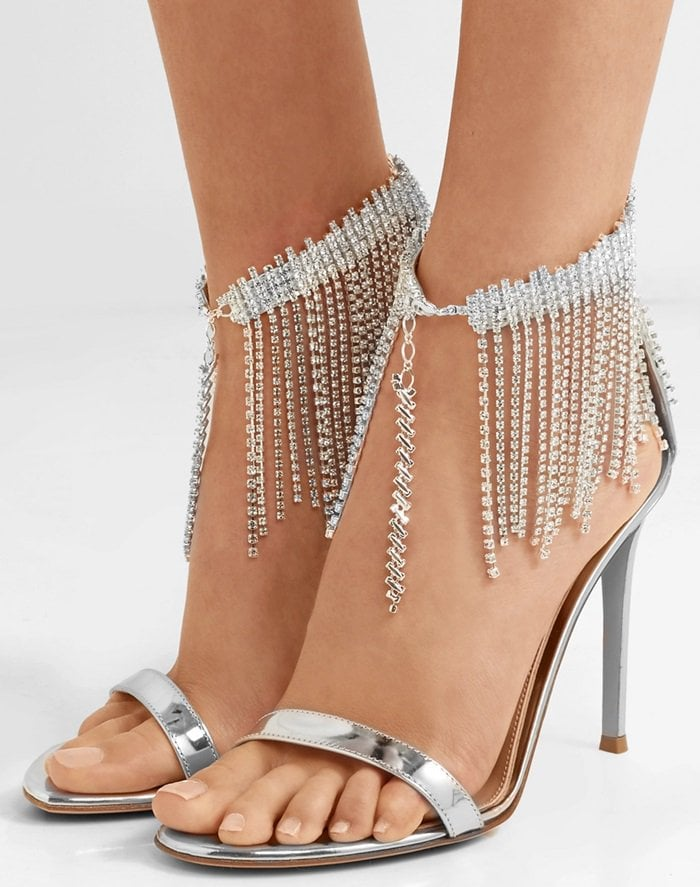This pair has been made in Italy from metallic leather and trimmed with swishy crystal fringing around the ankle strap