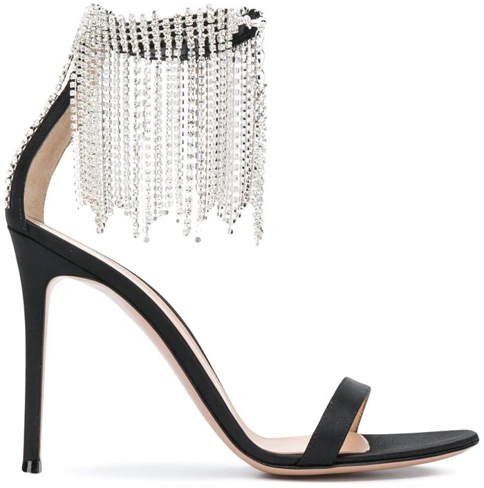 These black silk and leather crystal fringe trim ankle strap sandals feature an almond toe, a high stiletto heel, a branded insole, an ankle strap, and a crystal fringe trim