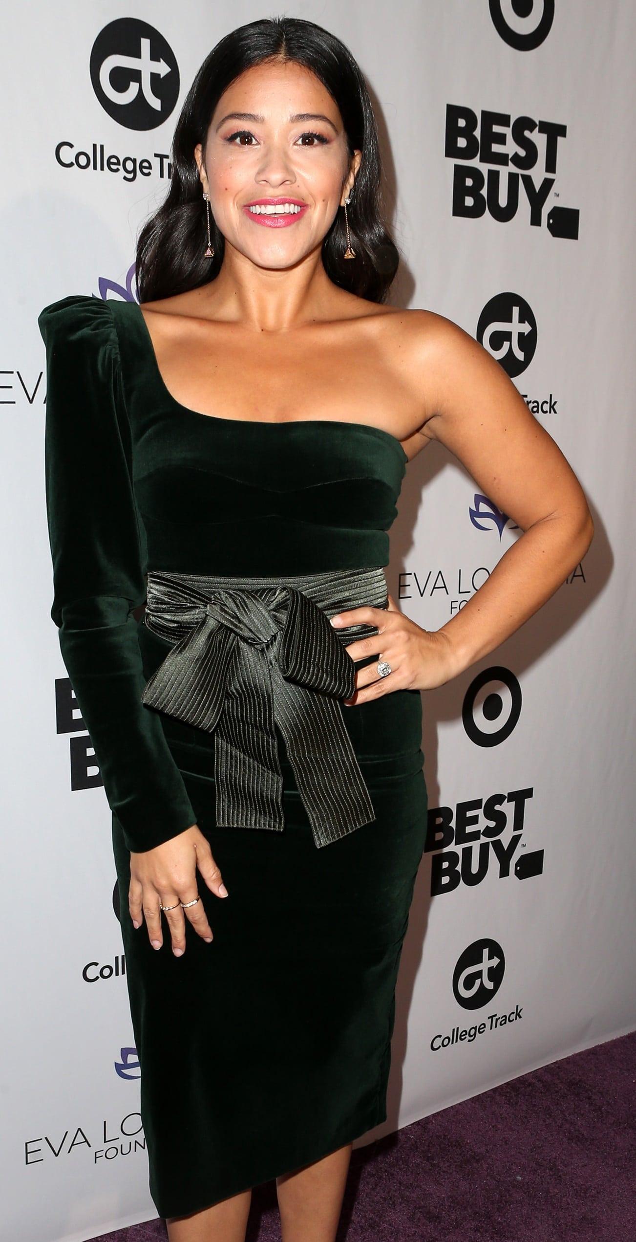 Gina Rodriguez wearing Silvia Tcherassi's Dianora one-shoulder cotton-blend velvet midi dress