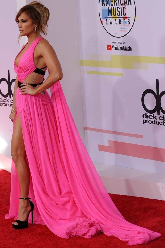 Jennifer Lopez flaunted her endless legs in a pink floor-length gown from Georges Chakra