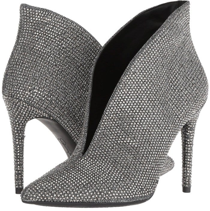 Tonal crystals explode like paparazzi flashes all over a shapely bootie styled with a dramatically notched topline and a beautifully round stiletto