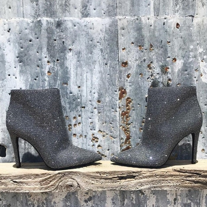 Spend your night dazzling like the star you are in these heeled ankle boots featuring a textile upper with allover crystal detailing
