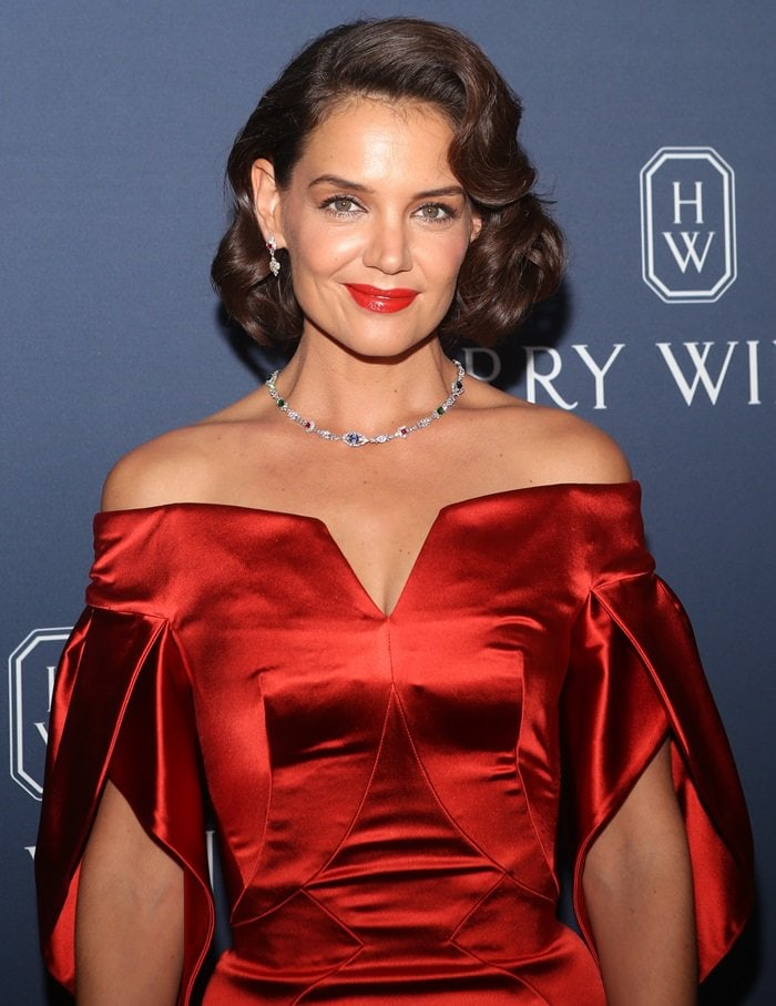 Katie Holmes wearing a shiny red silk cocktail dress by Zac Posen