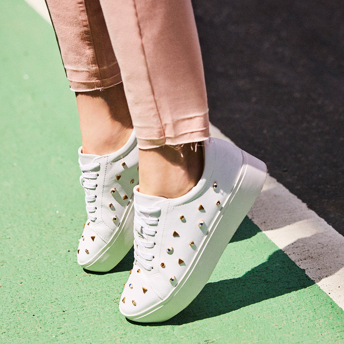 These platform sneakers in smooth Nappa leather boast cute decorations like all-seeing eyes, lips, and gilded shapes