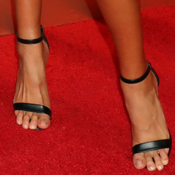 Kelly Gale shows off her feet in black sandals