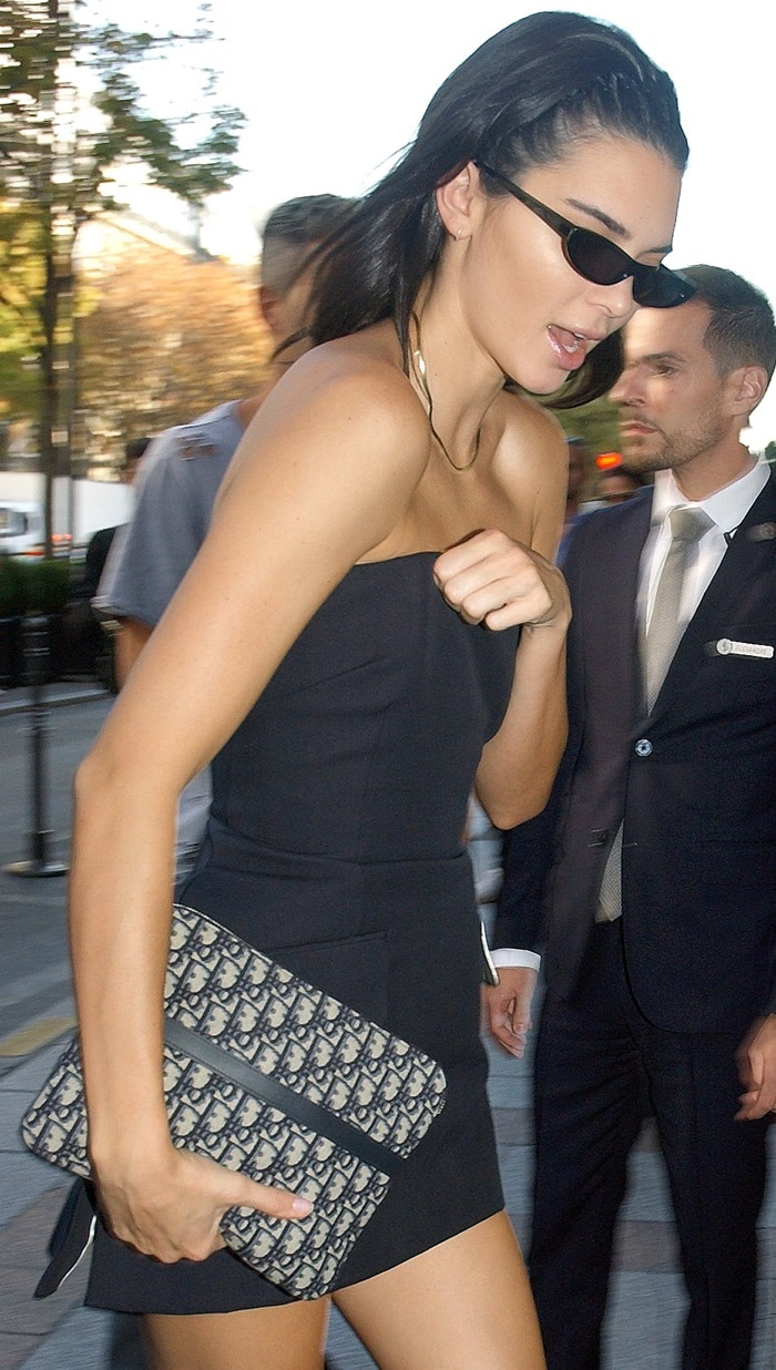 Kendall Jenner toting a travel bag in blue Dior Oblique jacquard canvas