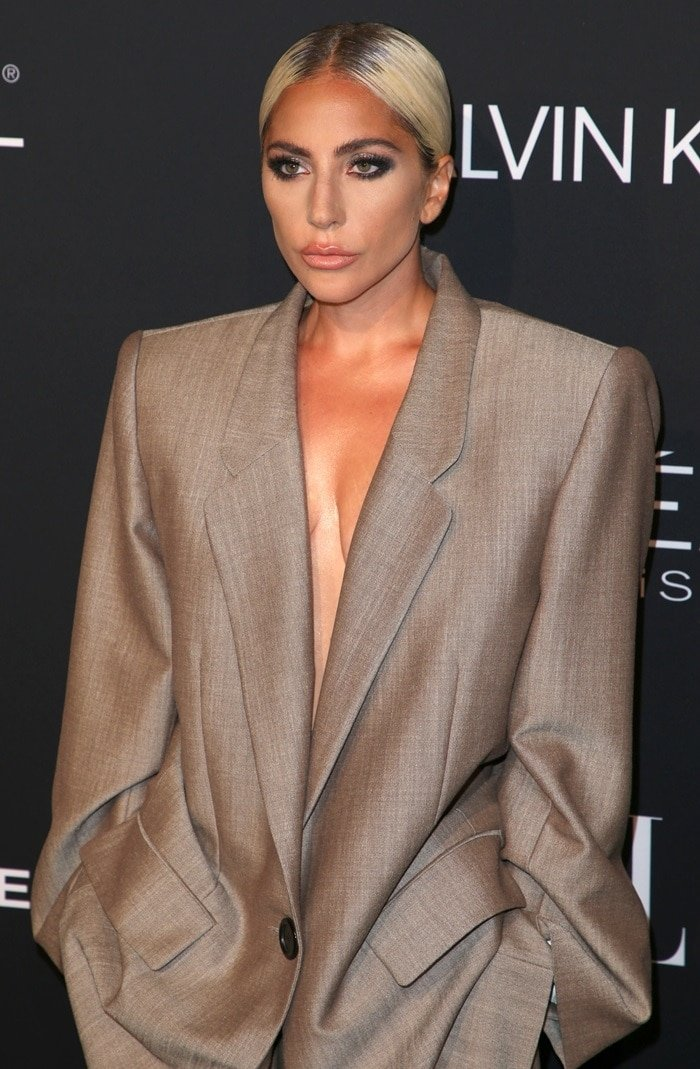 Lady Gaga wearingan oversized suit from the Marc Jacobs Spring 2019 Collection