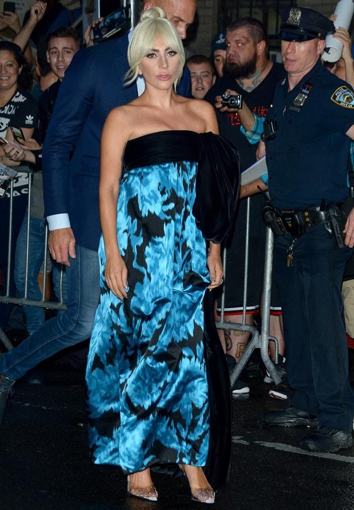 Lady Gaga'selegant carnation print silk strapless evening gown