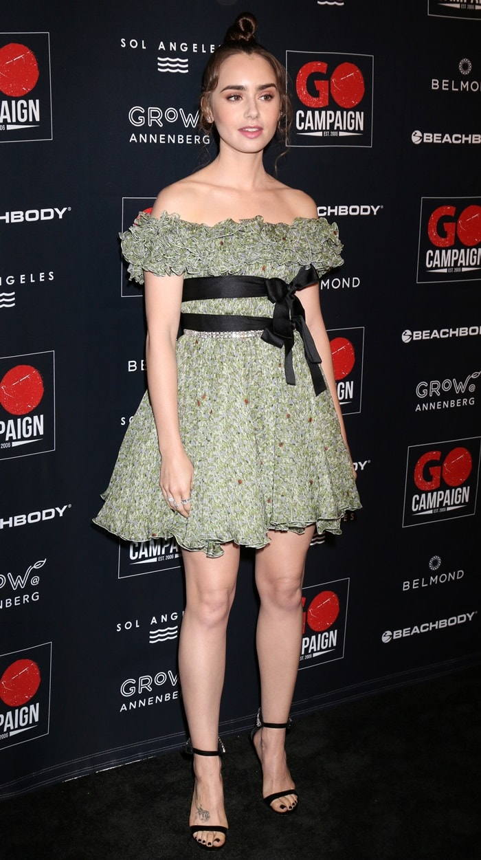 Lily Collins wearing an off-the-shoulder mini dress by Giambattista Valli