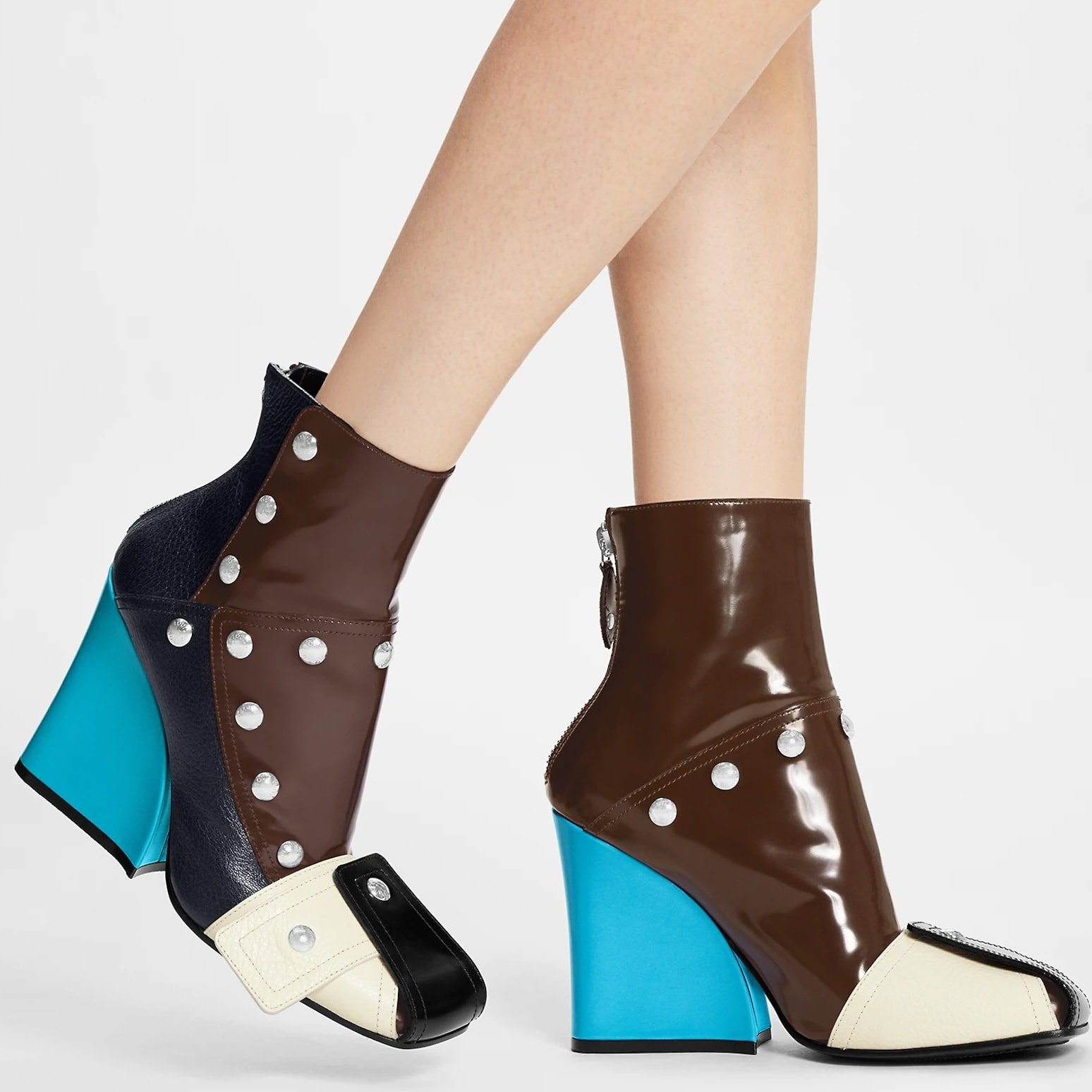Louis Vuitton's Patti wedge ankle boot combines calf leather with supple, grained goat leather