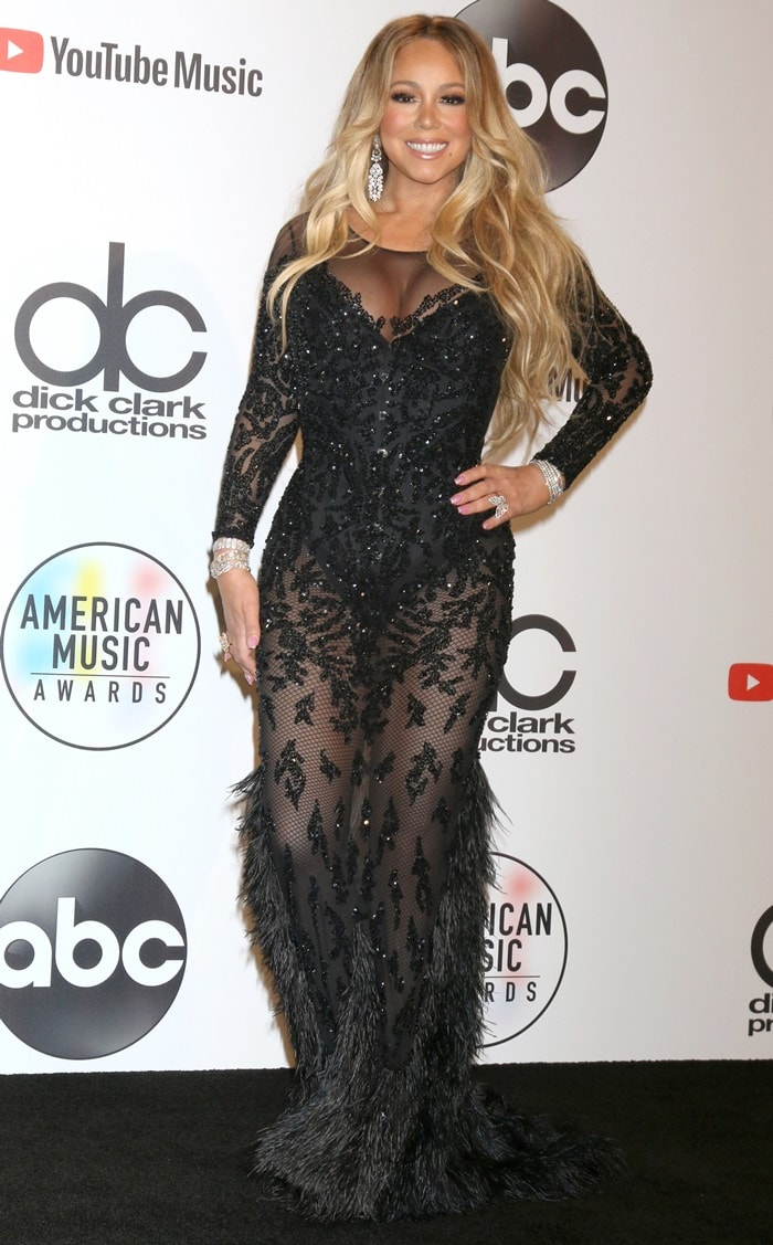 Mariah Carey's extremely dated-looking dress by Kuwaiti designer Yousef Al-Jasmi