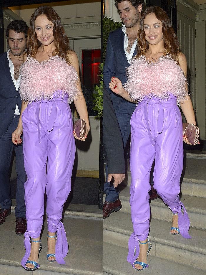 Olga Kurylenko stepping on the long ankle ties of her Attico light-purple leather pants