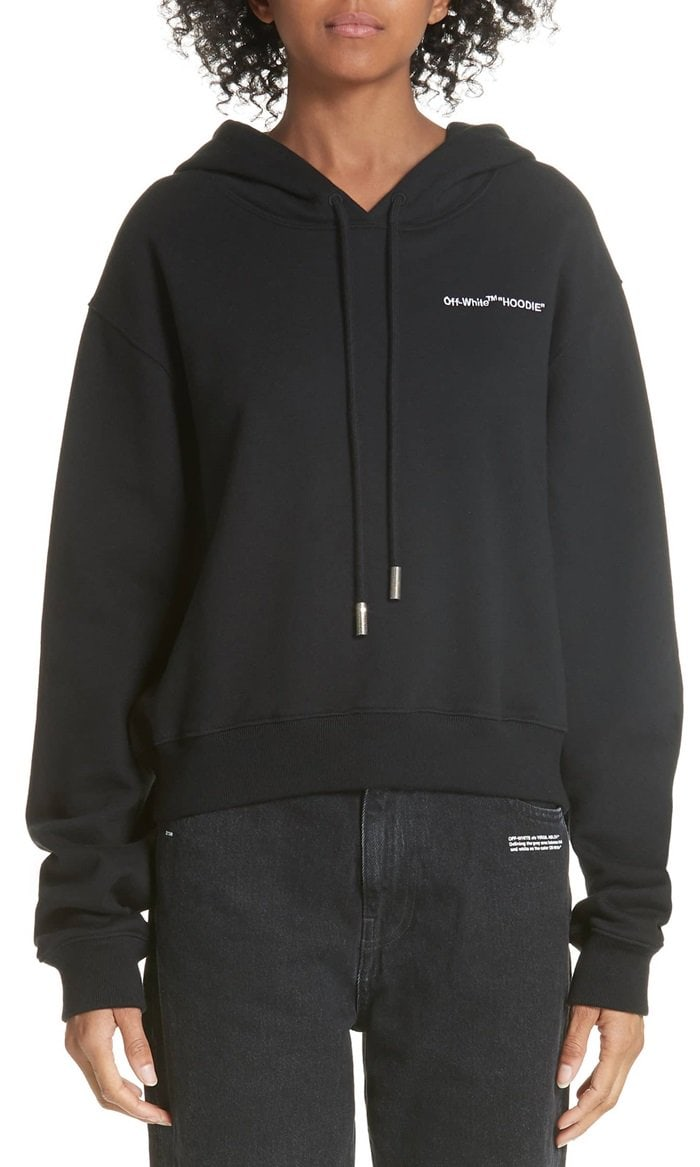 Tongue-in-cheek logo embroidery brands a cool, slouchy crop hoodie crafted in Portugal from pure cotton.